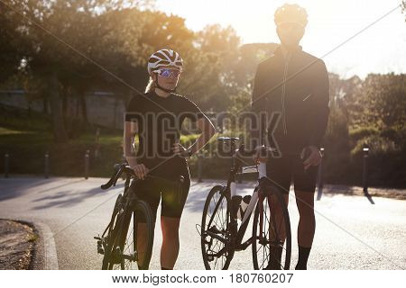 Active Sporty Man And Woman Wearing Protective Gear And Stylish Black Cycling Clothing Having Small