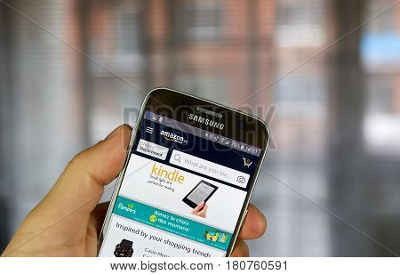 MONTREAL CANADA - MARCH 20 2017 - Amazon mobile application on screen of Samsung S5 in hand. Amazon is an American electronic commerce and cloud computing company.