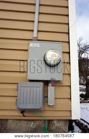 HARBOR SPRINGS, MICHIGAN / UNITED STATES - NOVEMBER 21, 2016: A Schlumberger watthour meter measures the electricity usage of a house in Harbor Springs.