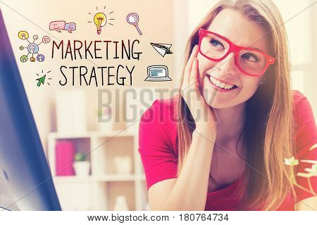 Marketing Strategy text with young woman in her home office