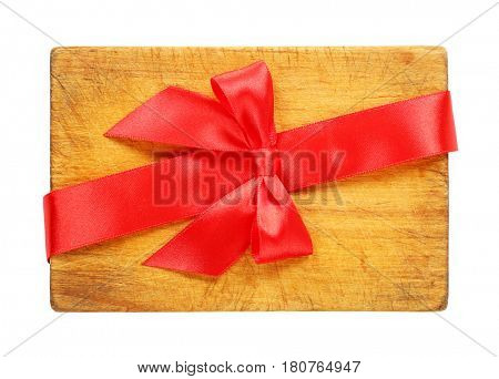 red ribbon bow tied over wooden cutting board