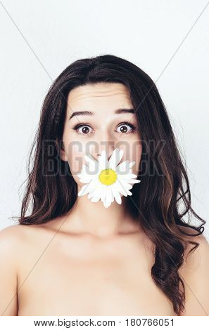 tender cute beautiful summer surprised young girl with camomiles flowers. beautiful topless body. white background