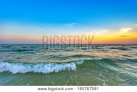 beautiful sunset at the sea with colorful shading of sunlight on sky