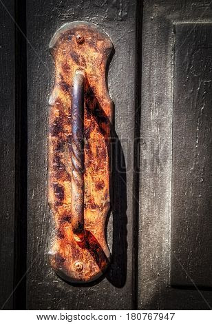 The handle to the front door of a Texas church.