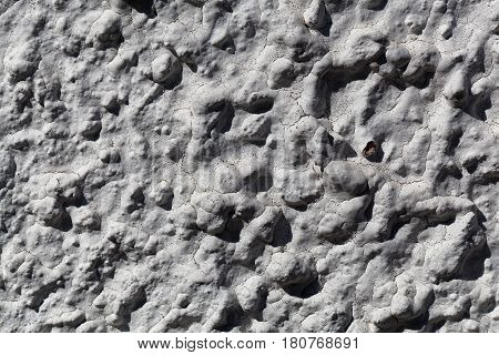 Macro photo of a coarse grained white colored plaster.