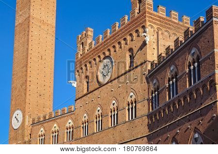Palazzo Pubblico and the Torre del Mangia on the Piazza del Campo in Siena, Italy
