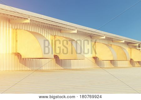 Air duct or hood for air conditioner system and roof with blue sky background.