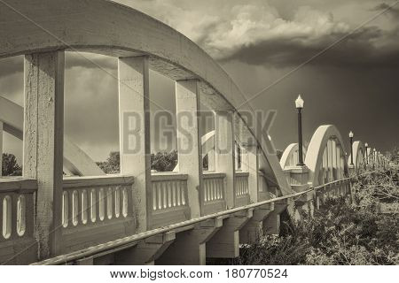 Rainbow arch bridge over South Platte River in Fort Morgan, Colorado, retro sepia toning