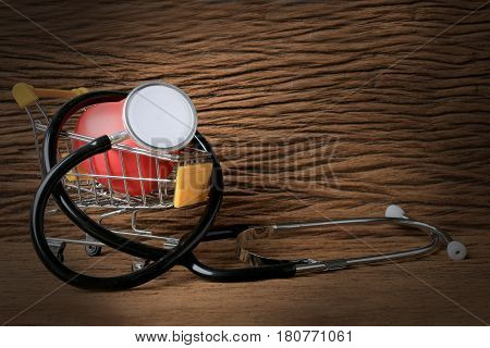 Still Life Painting Photography With Stethoscope And Red Heart Shape On Mini Shopping Carts Filled W
