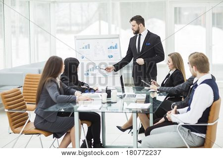 senior Manager of the company makes the presentation of a new financial project for the company's employees. the photo has a empty space for your text.