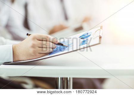 closeup of a businessman working with the marketing schedule for the workplace .the photo has a empty space for your text