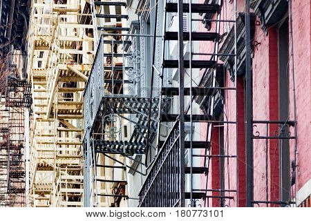 Fire escapes on the side of vintage buildings in the East Village neighborhood of Manhattan New York City NYC