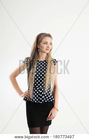 portrait of a young woman - administrator in a stylish suit on a white background. the photo has a empty space for your text
