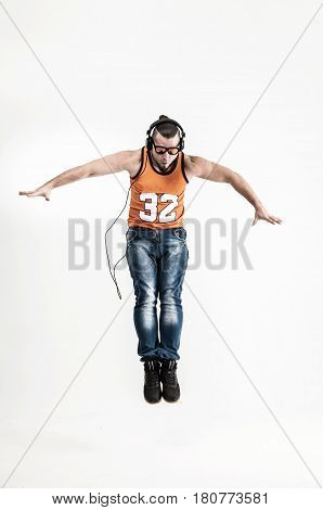 charming guy - rapper in headphones takes the dance break.photo on a white background and has an empty space for your text