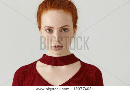 Studio Shot Of Redhead Caucasian Girl With Pretty Face With Freckles Wearing Trendy Red Dress With C