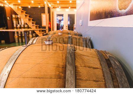 Wooden barrels or casks inside a brewpub tap house or restaurant.