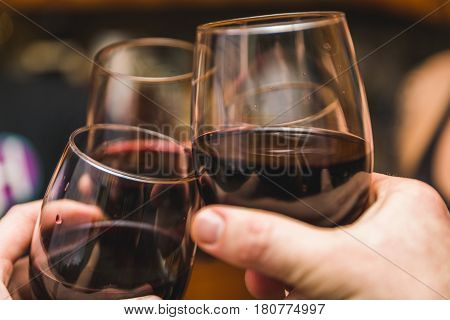 Three Wine Glasses Touching