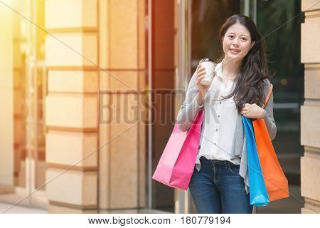 Woman Holding Shopping Bags And Coffee Cups