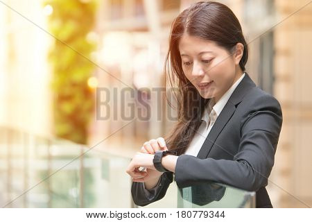 Happy Business Woman Looking At Her Smartwatch