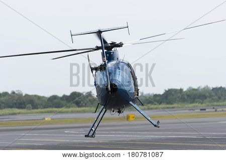 A jet Helicopter taking off from an airport