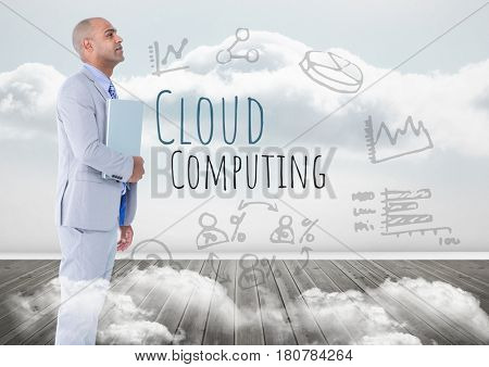 Digital composite of Man with laptop and Cloud Computing text with drawings graphics