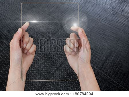 Digital composite of Hand holding glass tablet