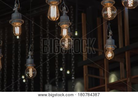 Lighting On The Chandelier In The Lamplight, Light Bulbs Hanging From The Ceiling, Lamps On The Dark