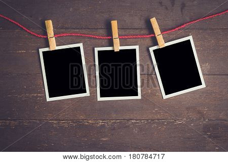 Photo Frame Hanging On Wood Table Background