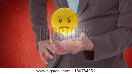 Digital composite of Close up of woman's hand with emoji and flare against red wall