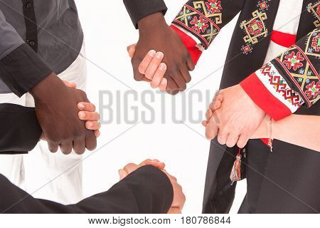 People holding hands. The concept of friendship, cooperation, collaboration, and teamwork.