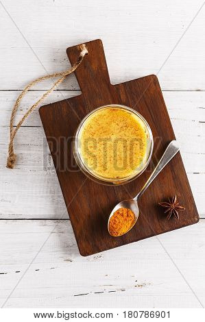 Flat Lay View Of Golden Latte Over White Wooden Table