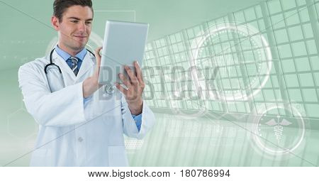 Digital composite of Happy doctor with his tablet