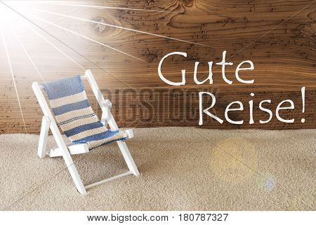 Sunny Summer Greeting Card With Sand And Aged Wooden Background. German Text Gute Reise Means Good Trip. Deck Chair For Holiday Or Vacation Feeling.