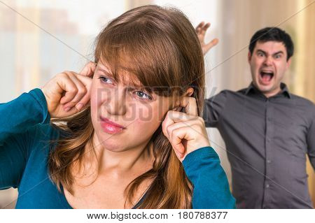 Couple arguing at home angry man screaming at his wife