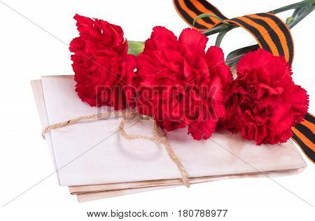 George ribbon with three red carnations bouquet - victory day concept isolated on white background
