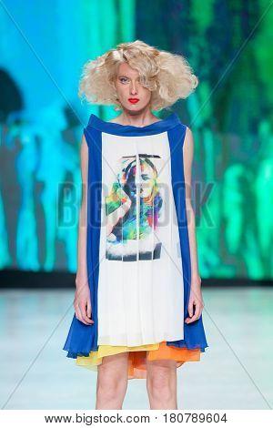ZAGREB, CROATIA - APRIL 01, 2017: Fashion model wears clothes designed by Marina Design at the 'Fashion.hr' fashion show