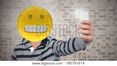 Digital composite of Selfie with predicament emoji face
