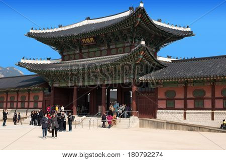 Seoul, South Korea - March 30, 2017: Locals and tourists at Gyeongbokgung palace, the main royal palace of the Joseon dynasty. Built in 1395, located in northern Seoul, South Korea