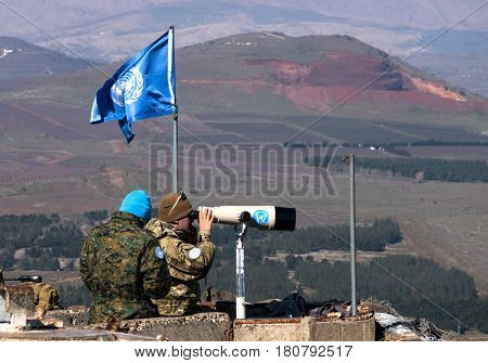 Golan Hights, Israel - February 18, 2017: U.N peace keeping soldiers observing the Israel - Syria  border from the Israeli side.