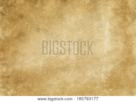 Aged and yellowed paper background or texture for the design. Grunge paper background.