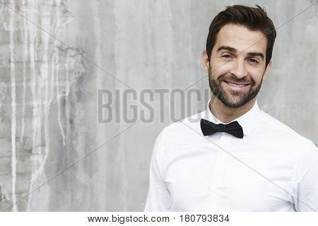 Bow tie dude smiling in white shirt portrait