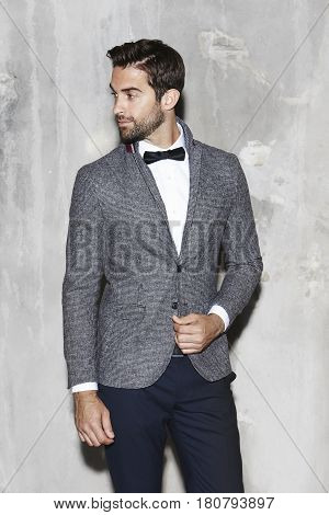 Dapper dude in grey jacket and bow tie