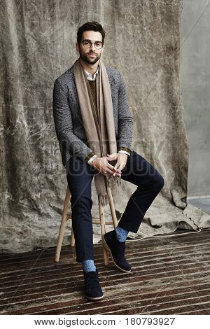 Portrait of dude wearing scarf in studio