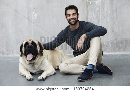 Dog and dude together in studio portrait