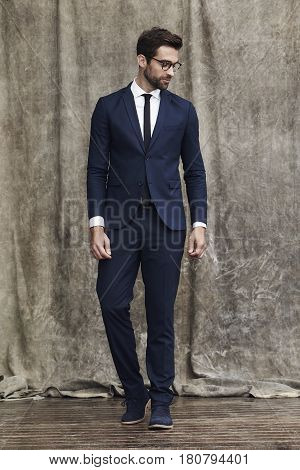 Stylish and Sharply dressed man in suit studio