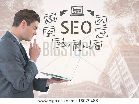 Digital composite of Businessman with tablet and SEO text with drawings graphics