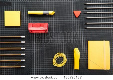 Top View Of Organized Various Office Supplies On Black Background