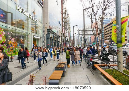 Seoul, South Korea - April 1, 2017: Locals and tourists at Seoul's famous Gangnam districs, known as a high end shopping location.