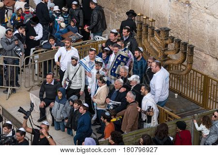 Jerusalem, Israel - December 30, 2016 : Bar Mitzvah at the western wall. The western wall is an exposed section of ancient wall situated on the western flank of the Temple Mount.