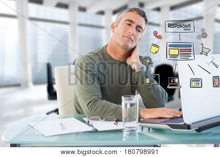 Digital composite of Digital composite image of businessman using laptop with icons at desk
